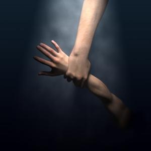 hand grabbing arm
